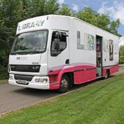 The mobile library in East Hatley, Cambridgeshire on 19th June 2018. The service is provided by Cambridgeshire County Council and comes to East Hatley on the third Tuesday of each month, from 11.15 to 11.30 am.