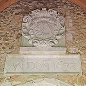 St Denis' church, East Hatley, Cambridgeshire – the newly cleaned Downing plaque, 13th April 2018. It's in the porch, above the door. Above the date is a cartouche of the arms of Sir George Downing, then owner of the estate of East Hatley.