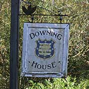 The sign for Downing House – originally 'The Downing Arms' but better known as 'The Scratching Cat' – on Lower Road, Croydon, Cambridgeshire. It closed in 1995 and is now a private residence.