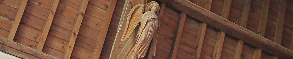 Roof angel in Hatley St George church, Cambridgeshire. There are eight in all decorating the supports of the church's hammerbeam roof.