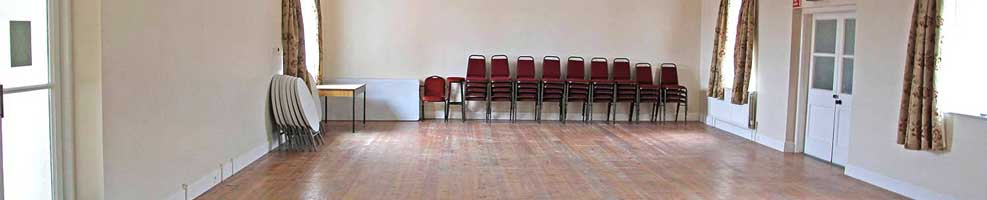 Hatley Village Hall – interior of the spacious hall, which has good acoustics. The floor is part carpet, part wood, making it ideal for meetings, talks and discos.