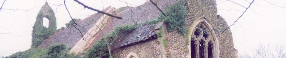 St Denis' church East Hatley, Cambridgeshire – in February 2003 when it was in a very sad state and before all the ivy had been removed.