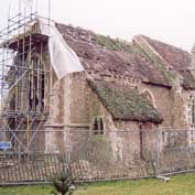 St Denis' church East Hatley, Cambridgeshire – in February 2003 after all the ivy had been removed and showing what a terrible state it was in.