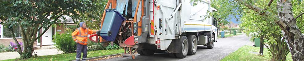 SCDC bin lorry on its regular Wednesday round to Hatley. South Cambridgeshire District Council normally empties green and blue bins one Wednesday, black the next.
