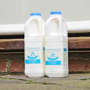 Doorstep milk delivered by the Hatley shop and post office.