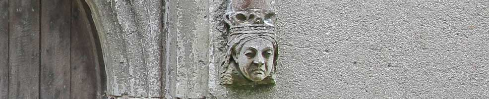 A stone head of Queen Victoria carved as a stop at the base of the south door arch at Hatley St George church, Hatley St George, Cambridgeshire.