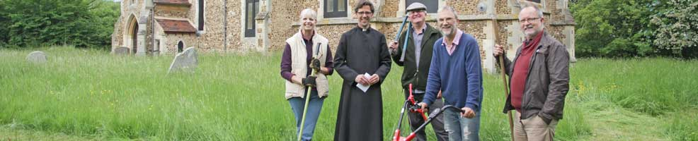 St Denis' church East Hatley, Cambridgeshire – blessing of the new mower. Under the churchyard management plan, the grass is allowed to grow very long – the Alco scythe (or scissor) mower makes cutting long grass relatively easy. Pictured left to right are Sarah Brennan, Reverend Steven Rothwell, John O'Sullivan, Peter Mann and Michael Pearson – 9-6-13. Photo: Philippa Pearson.