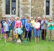 Happy volunteers at the St Denis' church East Hatley, Cambridgeshire, churchyard tidy-up on 4th August 2019.