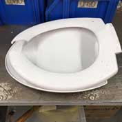 Found in a blue wheelie bin [5] – a-toilet seat. Only things which can be recycled easily (so not hard plastics) should be put into your blue bin. SCDC has a list on its website.