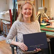 Jenny Ollerenshaw with the St Denis' church visitors' book she made – 10th September 2019. Jenny lives in East Hatley and does bookbinding as a hobby.