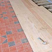 St Denis' church, East Hatley – work in progress during the first phase of the FoFC's restoration project, April 2018.  This is the new floor tiling and boards in the nave.