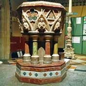 All Saints, Margaret Street, London – the fine marble font and, behind, the Paschal candle stand, a copy of the one in the Certosa in Pavia, Italy.