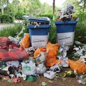 Piles of rubbish left besides the overflowing litter bins  at Grantchester Meadows – if bins are full, please take your waste home.