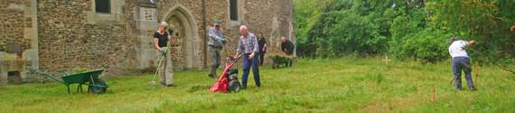 The St Denis' churchyard tidy-up – Sarah Brennan, John O'Sullivan, Charlie Norman with the 'St Denis' scissor mower, Carole Cooper, Neil Carter and Nicola Jenkins. / 19 July 2020. Photo: Peter Mann.