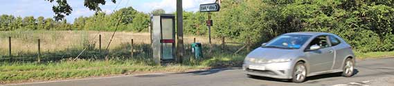 The payphone box in East Hatley, August 2020. Both it and the phone box in Hatley St George are under threat from BT which feels the boxes are not used enough to justify keeping them.