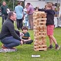 Len Thomas' photo of a boy building a tower block at Hatley and Gamlingay Church Fête in Hatley St George, Cambridgeshire, 29th August 2021.